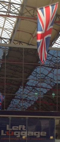 Union flag in railway station above Lost luggage sign